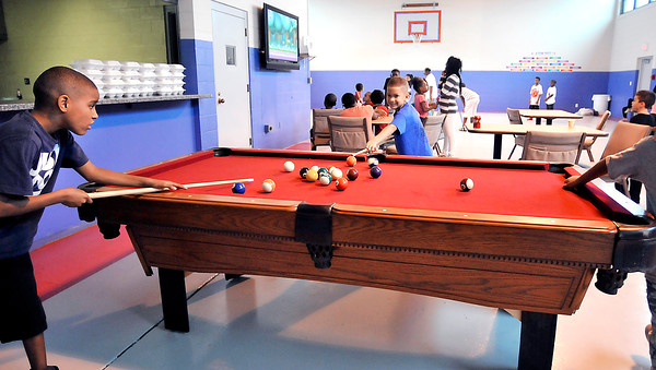 John P. Cleary    The Herald Bulletin<br /> First day of activities for the new Girls & Boys Club at 2828 Madison Ave. Here the kids enjoy playing pool.