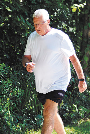 John P. Cleary | The Herald Bulletin   POH series<br /> Senior citizen Stephen Hedgecraft works out with friends at Mounds State Park where he walks and runs.