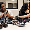 John P. Cleary | The Herald Bulletin<br /> Christian Felder and Joshualenne Beard, students in AHS's D26 Career Campus employment skills class, clean and polish shoes that were donated to Jacara's Closet.