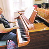 Don Knight | The Herald Bulletin<br /> Karen Barnard plays the piano at Vermillion Place on Thursday.