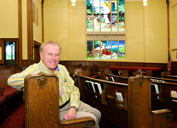 Don Knight | The Herald Bulletin First Presbyteiran Church Pastor Kevin Bausman sits in the church's sanctuary on Thursday. The church is celebrating their 165th anniversary this weekend.