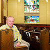 Don Knight | The Herald Bulletin<br /> First Presbyteiran Church Pastor Kevin Bausman sits in the church's sanctuary on Thursday. The church is celebrating their 165th anniversary this weekend.