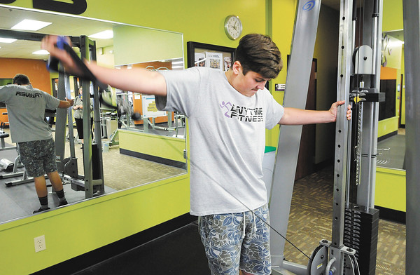 Don Knight | The Herald Bulletin<br /> Robert Widener works out at Anytime Fitness in Anderson on Thursday.