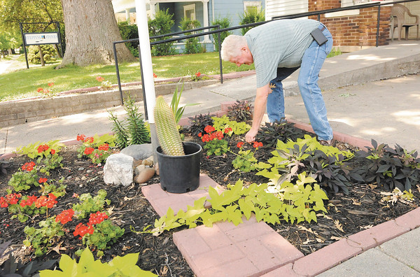 Don Knight   The Herald Bulletin<br /> Tim Montgomery tends to the garden at Stepping Stones in Anderson where he lives.