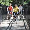 John P. Cleary | The Herald Bulletin    POH-part 5<br /> Melinda Pierce, with her husband Mike, right, and son Xavier, 13, left, ride their bikes along the trails at Shadyside Park.