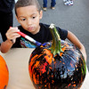 John P. Cleary |  The Herald Bulletin<br /> Charles Ballard, 4, works on covering his pumpkin with paint during the  Harvest Fest - Family Fun Fall Festival held Saturday evening at Hoosier Park.