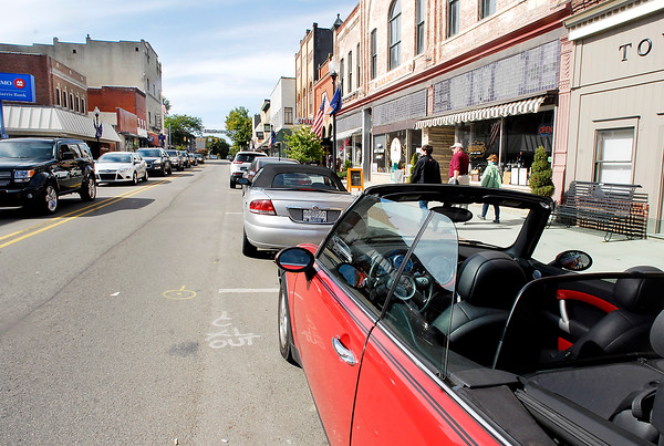 John P. Cleary | The Herald Bulletin<br /> Curb parking is full along State Street in downtown Pendleton as traffic backs up from Pendleton Ave.