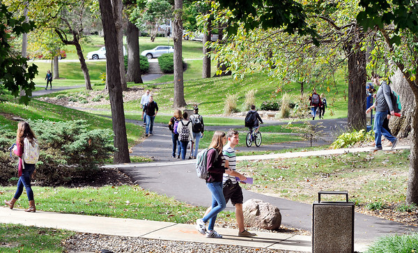 John P. Cleary   The Herald Bulletin<br /> Students walk through the valley on the Anderson University campus as they move between classes Tuesday afternoon.