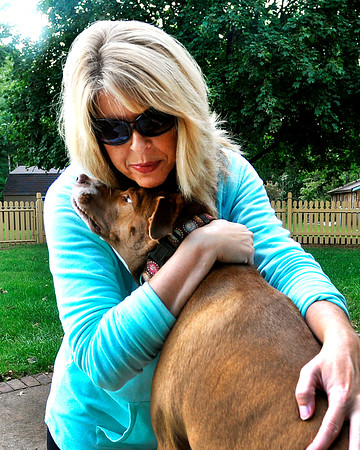 John P. Cleary | The Herald Bulletin<br /> Susan Blake gives her rescued dog Buddy a hug.