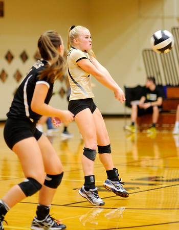 Don Knight | The Herald Bulletin<br /> Madison-Grant's Kanani Price passes the ball as the Argylls faced the Alexandria Tigers on Saturday.