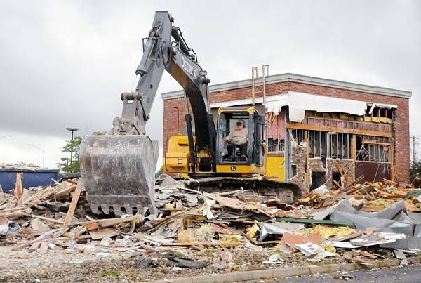 Don Knight | The Herald Bulletin<br /> Todd Davis, owner of Davis Excavating, demolishes the former Grindstone Charly's on Scatterfield on Friday to make way for a Hardees.