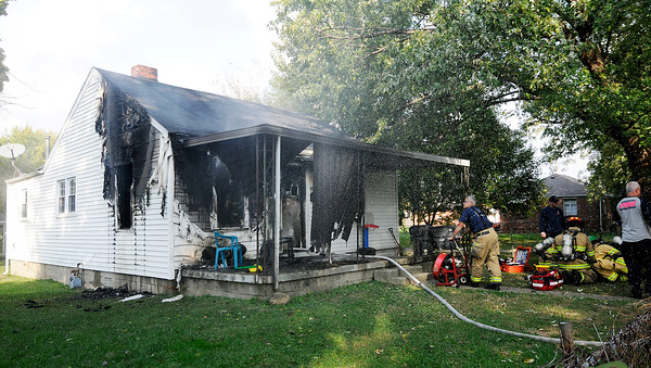 Don Knight | The Herald Bulletin<br /> AFD overhauls the fire scene at 404 East 36th Street as a group of firefighters try and revive two pets on Wednesday. Both pets died of smoke inhalation.
