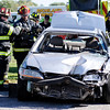 Don Knight | The Herald Bulletin<br /> Richland Township Volunteer Fire Department conducts an extraction demonstration during their public safety fair at Evermilk on Saturday.