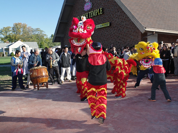 Mark Maynard   For The Herald Bulletin<br /> Designed to expel evil and bring good fortune, the Lion Dance is performed at the Pho Minh Buddhist Temple during opening ceremonies.