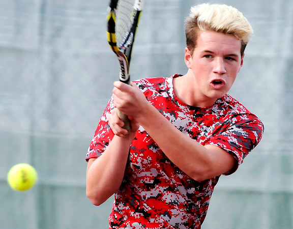 John P. Cleary | The Herald Bulletin<br /> Anderson's #1 singles Andrew Duquine returns a backhand shot during the first round of sectional play against Alexandria.