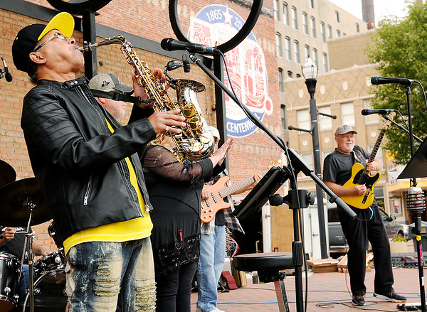 Don Knight | The Herald Bulletin<br /> Teddy Patterson on sax with The Forte Reunion Band during the first Socktoberfest at Dickmann Town Center on Saturday. Other musicians included Martha Green, Terry Stephens, Chic Brown, Mark Burton, Scott Ireland, Rex Williamson and  Raul Sanchez.