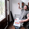 John P. Cleary |  The Herald Bulletin<br /> Disabled veteran Tim Senkowski in his house that was built for him but now has issues with things needing finished or fixed with the structure. Time points out issues with the front door and windows around it.