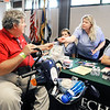 John P. Cleary |  The Herald Bulletin<br /> Air Force veteran Dale Arthur, of Alexandria, talks with the students of the Ivy Tech Dental Hygiene Program about services they offer for veterans while attending the 2017 Madison County Veterans Stand Down event Friday.