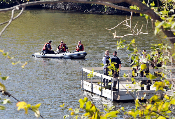 John P. Cleary |  The Herald Bulletin<br /> The Anderson Fire Department puts their water rescue boat in the water at Shadyside Lake Wednesday afternoon after a body was discovered in the water along the northern bank of the lake.