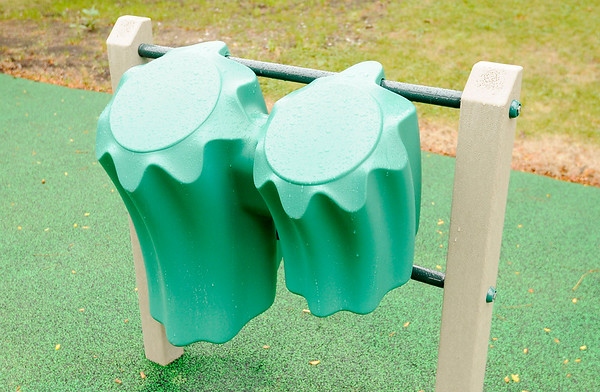 Don Knight | The Herald Bulletin<br /> A set of drums are part of the new equipment for special needs children Pendleton Elementary added to their playground.