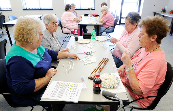 Don Knight | The Herald Bulletin<br /> Clockwise from left, Mardel McKay, Phyllis Downham, Juanita Crisp and Barbara Pickel play Mexican Chain Dominoes at the Community Hospital Anderson Education Building on Monday. Next month's senior activity is Brushes and Beverages on November 6th at Primrose Retirement Home from 6-8 p.m. Artist Kim Peyton will be leading the class RSVP by calling 765-643-5000.