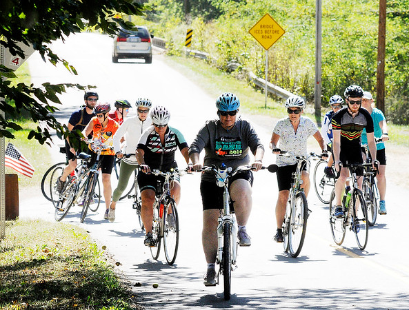 Don Knight | The Herald Bulletin<br /> Cyclists start out on a 25 mile ride during the Ride for the Mounds event at Canoe Country on Saturday. Riders travel along roads near potential routes for the Mounds Greenway.