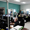 Don Knight | The Herald Bulletin<br /> Lynn Edens answers a call at Madison County's Central Dispatch.