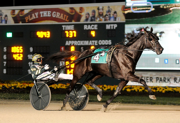 Don Knight   The Herald Bulletin<br /> Hannelore Hanover, the only mare racing Saturday, driven by Yannick Gingras easily wins the first open elimination Breeders Crown race at Hoosier Park on Saturday.