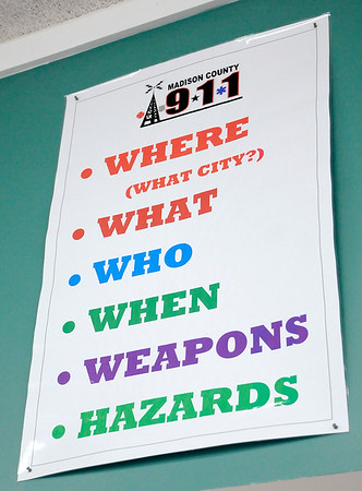 Don Knight | The Herald Bulletin<br /> List of questions starting with where the emergency is at are displayed on the wall at the Madison County Central Dispatch. Dispatchers want to know the where first so they can get units in route as they continue to gather more information.