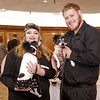 Mark Maynard | For The Herald Bulletin<br /> At the Madison County Humane Society's 8th Annual Fur Ball, Nikki Sanchez holds Skipper while Cameron Moore holds Skipper's mother, Lucy, who are available for adoption as a pair.