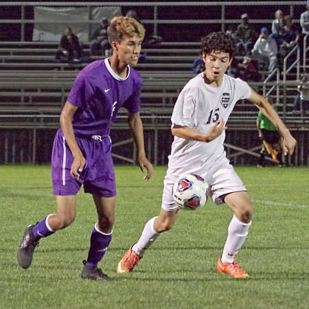 Mark Maynard | For The Herald Bulletin<br /> Anderson High School's Angelo Roman races a Muncie Central player for the ball during their Boys Soccer Sectional match.