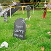Don Knight | The Herald Bulletin<br /> Sheila Pierce decorated her yard on North Street in Chesterfield with headstones for Halloween. Pierce said she decorates for Halloween, Christmas and Easter.