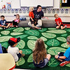John P. Cleary |  The Herald Bulletin<br /> Samantha Pearse gathers her 4-year-old pre-K students onto the carpet for a song and a story at Elwood Elementary School this past week.