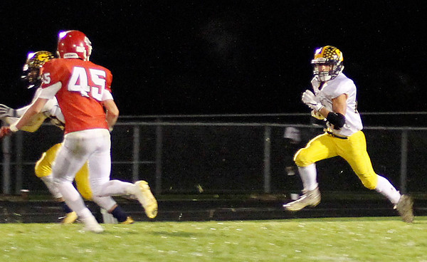 Chris Martin | For The Herald Bulletin <br /> Shenandoah's Joe Huff runs the ball in a Sectional game at Frankton Friday night.