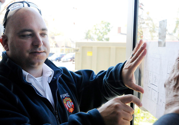 Don Knight | The Herald Bulletin<br /> AFD Deputy Chief Todd Cawthorn points out changes in the floor plan that are part of renovations to AFD's headquarters on Tuesday.