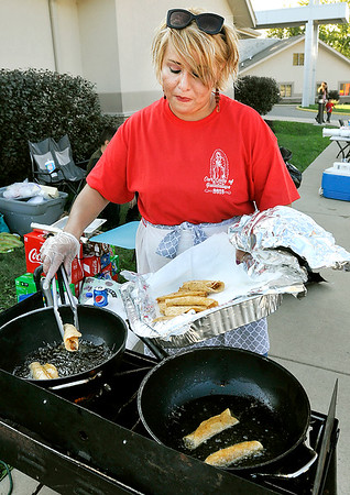 John P. Cleary    The Herald Bulletin<br /> St. Mary's Church Hispanic Ministry member Nancy Floiesperez fries up taco shells to be filled by hungry visitors at the annual Hispanic Heritage Festival held Saturday.