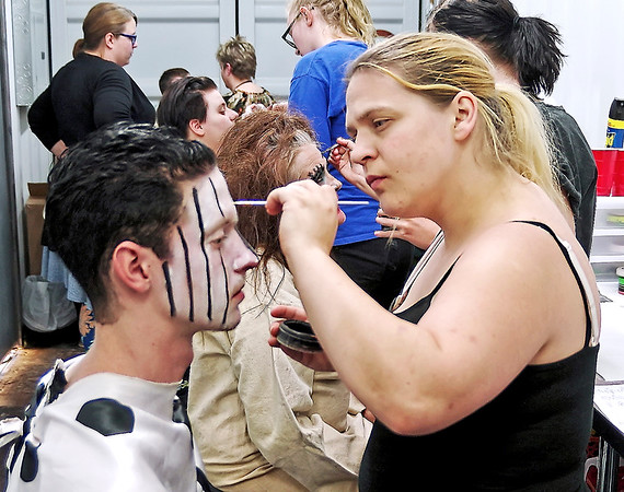 Mark Maynard | for The Herald Bulletin<br /> Crawfordville make-up artist Kodi Swank adds details to the face of Indy Scream Park Midway clown Nick Bardull of Anderson.