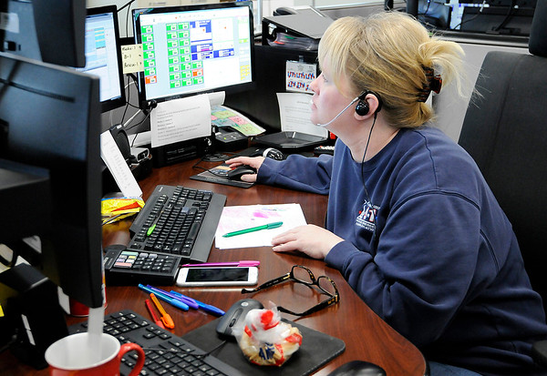 Don Knight | The Herald Bulletin<br /> April Baker responds to a call about a body being found by a fisherman during a 12-hour-shift at the Madison County's Central Dispatch.