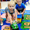 John P. Cleary |  The Herald Bulletin<br /> Violet Jones and Keagan Box drive their toy trucks around the room as they play in Elwood Elementary School's 16-29 month ols pre-K classroom this past week.