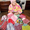 John P. Cleary |  The Herald Bulletin<br /> Betty Lawrence shows off some of about 130 hats that she has crocheted, and donated, to Community Hospital for their annual Keith Trent's Coats of Caring event.