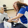 Don Knight | The Herald Bulletin<br /> Danielle Hornberger with St. Vincent checks David Humphrey's blood pressure during Operation Lifesaver at the Millcreek Civic Center in Chesterfield on Saturday.
