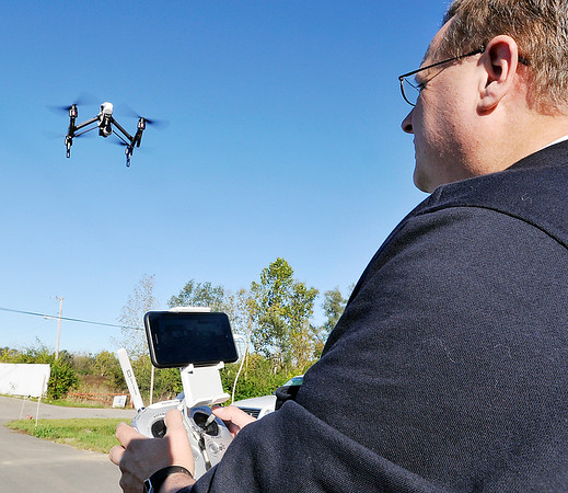 John P. Cleary    The Herald Bulletin<br /> Madison County Emergency Management Agency Public Information Officer Todd Harmeson demonstrates their UAV, or Unmanned Aircraft Vehicle, the agency has for use in investigations and searches.