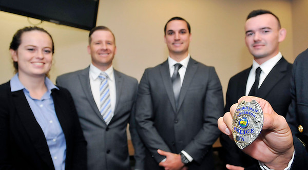 John P. Cleary |  The Herald Bulletin<br /> Anderson Police Department recruits Courtney Skinner, Andrew Lanane, Sean Brady and Adam Watters took their oath of office to become APD's newest police officers Friday.