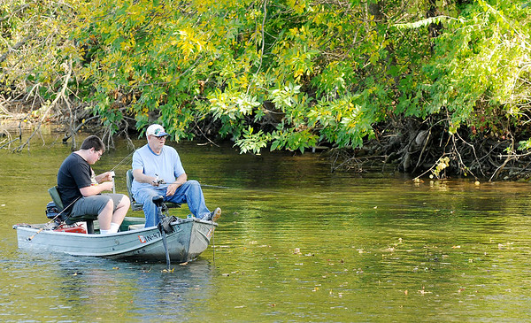 Don Knight | The Herald Bulletin<br /> Anglers cast to the bank as they try their luck at Shadyside on Saturday. The National Weather Service is forecasting highs in the 70s this week.