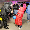 Don Knight | The Herald Bulletin<br /> Dressed as an inflatable fan man, Jackson Gumm, 5, gets candy from Max Johnson who is wearing a scary clown mask during APD's Trunk or Treat on Friday. Johnson was volunteering with the group Second Chance To Get It Right. The event was moved into APD's parking garage due to the rain.