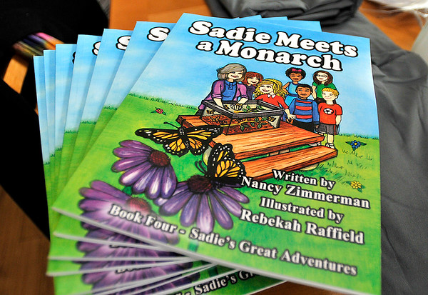 "John P. Cleary |  The Herald Bulletin<br /> Nancy Zimmerman wrote a new children's book called ""Sadie Meets a Monarch."" This is the fourth book of Sadie's Great Adventures that Zimmerman has written."