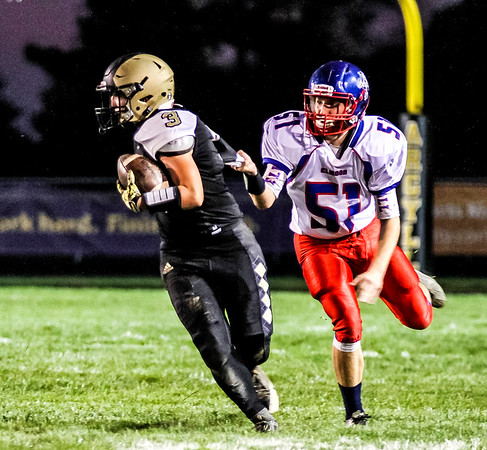 Chris Martin   for The Herald Bulletin.<br /> Madison-Grant's Dylan Brooks scrambles Friday night at home against Elwood.