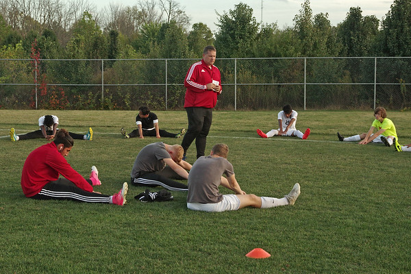 Mark Maynard | For The Herald Bulletin<br /> Anderson High School Boys Soccer Coach Chris Spolyar addresses the team as they prepare for their Sectional confrontation with the Indian's historic rival, the Muncie Central Bearcats.