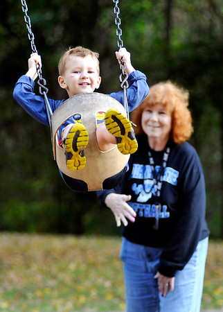 John P. Cleary |  The Herald Bulletin<br /> Barbara Morlock, of Pendleton, pushes her great-grandson, Adam Beisser, 3, in the swing as they enjoy an outing in Mounds State Park Monday afternoon.