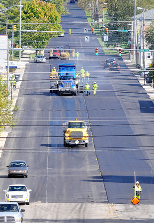 John P. Cleary |  The Herald Bulletin<br /> The Eighth Street paving project continues through Anderson as E&B workers lay down new asphalt in the center lanes along east Eighth Street in Park Place Monday afternoon. An update from the city says the paving project is scheduled for completion on October 26th.